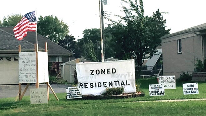 In September 2015, signs are across the street from a proposed mosque on 15 Mile between Ryan and Mound in Sterling Heights.