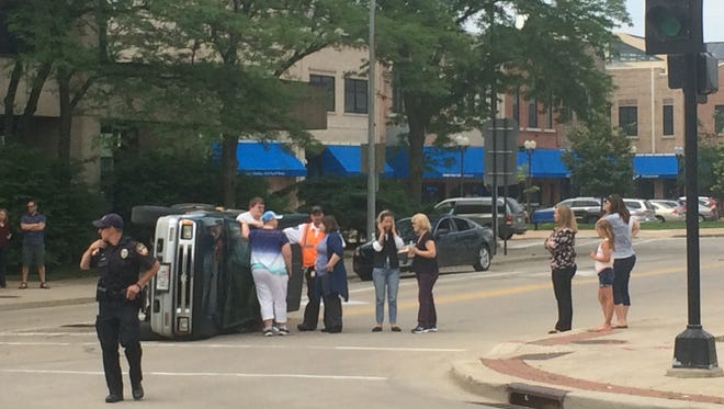 Oshkosh police and firefighters respond Wednesday to a crash at North Main Street and Pearl Avenue.
