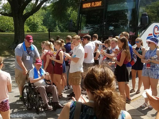 Students from Manitowoc Wilson Junior High great WWII veterans arriving from an Honor Flight at the Iwo Jima Memorial in Washington D.C. June 13.