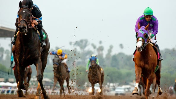 Shared Belief and jockey Mike Smith, left, defeat California