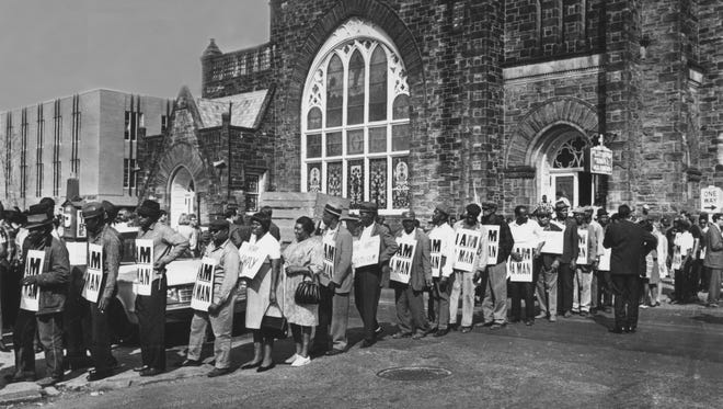 Sanitation workers and supporters line up at Clayborn Temple to begin their march to downtown March 29, 1968, a day after a march led by Dr. Martin Luther King Jr. ended in violence. (The Commercial Appeal)