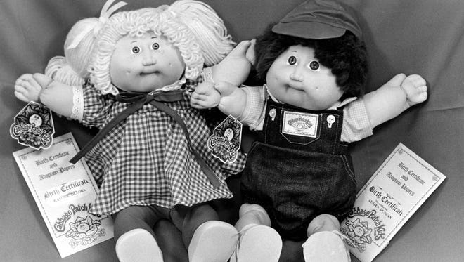 Dec. 10, 1983, two Cabbage Patch Kids dolls are shown on display.