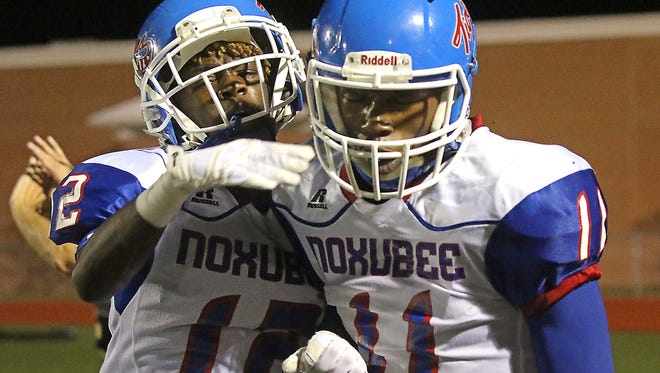 Noxubee County's Kaddarrion Outlaw (12) celebrates a large gain by Kymbotric Mason (11) during the second half of the game against Starkville High.. (Jim Lytle / For The Clarion-Ledger)