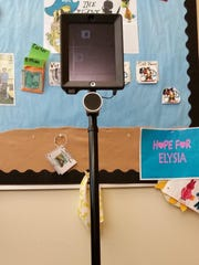 The telepresence unit used by Elysia Mirales can turn and move backward and forward. The iPad screen also can be raised.