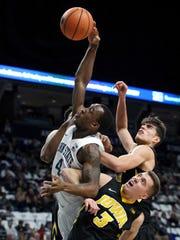 Penn State Nittany Lions guard Nazeer Bostick (4) drives