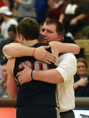Morgan coach Adam Copeland hugs senior Marty Sidwell following the Raiders 58-50 loss to Meadowbrook in a Division II sectional tournament game on Tuesday night at The Corral. Sidwell posted team highs of 18 points and 11 rebounds.