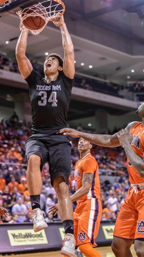 Texas A&M center Tyler Davis (34) dunks the ball over
