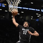 Minnesota center Karl-Anthony Towns (32) drives during the first half Sunday. Towns lead the Wolves with 24 points.
