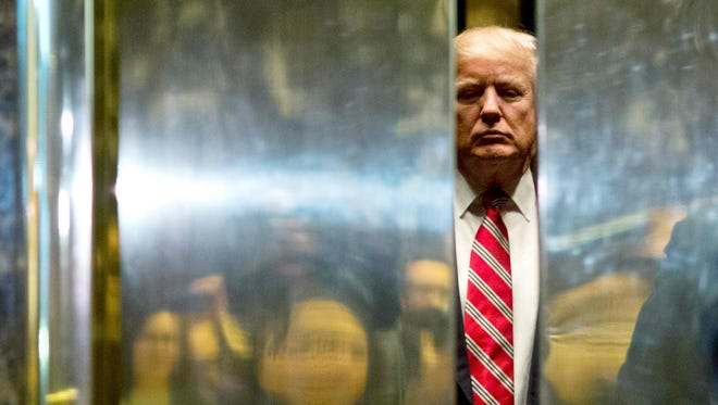 President-elect Donald Trump boards the elevator at Trump Tower on Jan. 16, 2017, in New York.