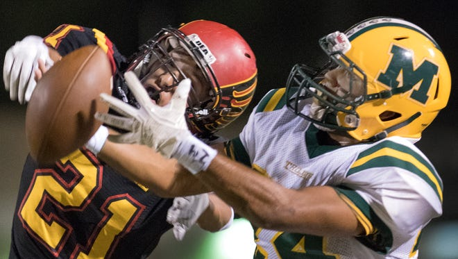 Centennial defensive back Joseph Hernandez swats the ball away from Mayfield receiver Nasiem Al-Abayad during first quarter action Friday night at the Field of Dreams.