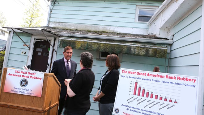Senator Jeff Klein speaks with Stephanie Rojas, Housing Director of the Rockland Housing Action Coalition, and Housing Counselor Manoella Taunton after a press conference in front of a zombie property in Spring Valley, May 11, 2016. Senators Jeff Klein and David Carlucci called for new legislation to monitor bank-owned homes and zombie properties.
