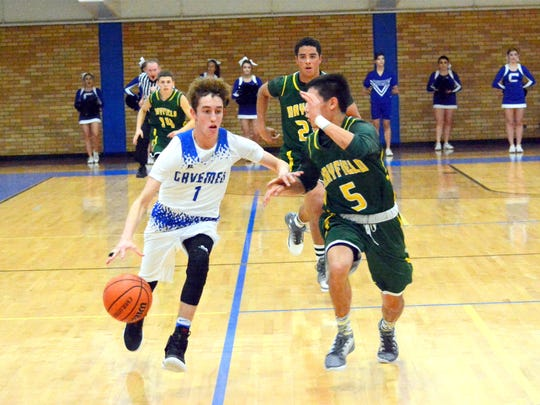 Carlsbad's Josh Sillas comes up with a steal and heads toward the basket in the second quarter Friday.