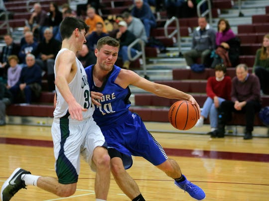 Shore Regional's Kyle Koob dribbles around Colts Neck's Zach Albom during the 2017 Albert E. Martin Buc Basketball Classic at Red Bank Regional High School in Little Silver, NJ Wednesday, December 27, 2017.
