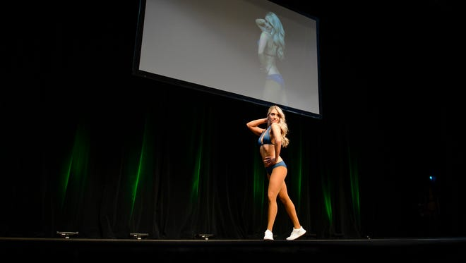Philadelphia Eagles cheerleader prospect Dana Pasqualone, a councilwoman in Washington Township, performs onstage as tryout finals are held Thursday, April 19, 2018 at the Kimmel Center in Philadelphia, Pa. Pasqualone made the team.