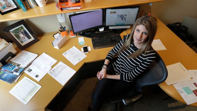 Jennifer Kalies, vice president of marketing and communications for Performa Architects and Engineers, pictured in her office on North Broadway in De Pere.