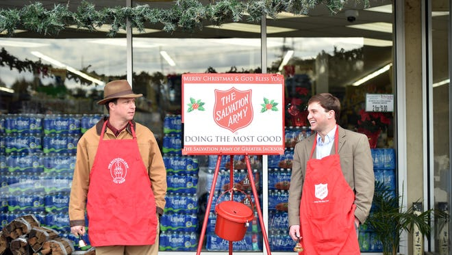 Bell ringers Ken Booker, left, and Steele Dehmer solicit donations for Salvation Army from passersby Thursday at McDade's Market at Maywood Shopping Center in Jackson.
