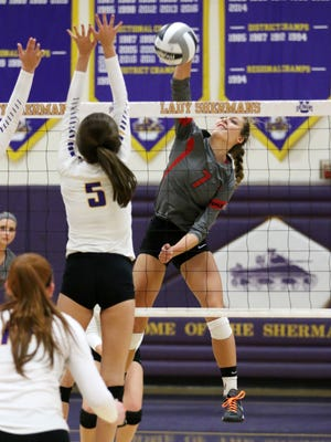 Piketon's Cami Chandler spikes a ball at the net while Unioto's Madi Eberst defends. Chandler leads the area in kills while Eberst ranks second in the area in assists.