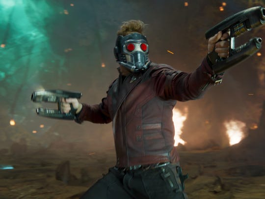 "Star-Lord (Chris Pratt) takes fire in ""Guardians of"
