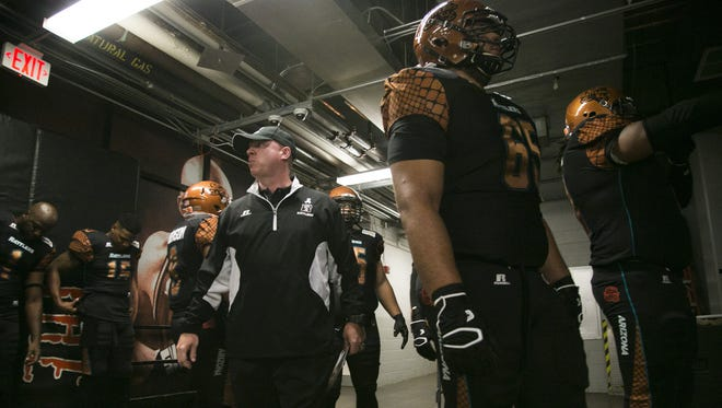 Rattlers' Kevin Guy walks and talks to his team before a game agains the Kiss at US Airways Center in Phoenix, AZ on July 25, 2015.