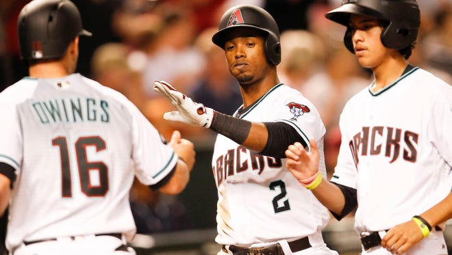 Arizona Diamondbacks' Jean Segura celebrates after Chris Owings  scores against the Pittsburgh Pirates on Friday, April 22, 2016, at Chase Field in Phoenix, Ariz.