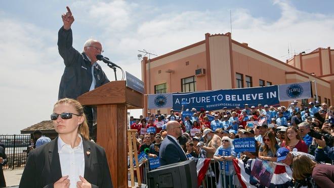 Supporters of Democratic presidential candidate Sen. Bernie Sanders, I-Vt., line up before a campaign rally at the Los Angeles Maritime Museum in San Pedro district of Los Angeles Friday, May 27, 2016.