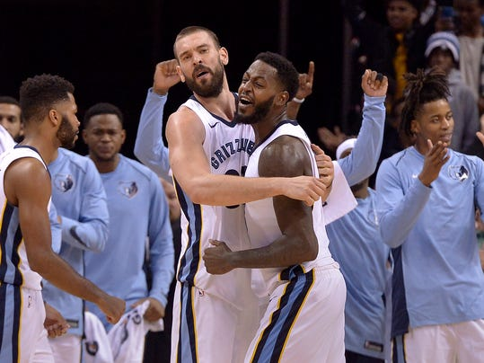 Memphis Grizzlies center Marc Gasol, center left, and forward JaMychal Green, center right, celebrate with teammates after an NBA basketball game against the Minnesota Timberwolves Monday, Dec. 4, 2017, in Memphis, Tenn. The Grizzlies won 95-92. (AP Photo/Brandon Dill)