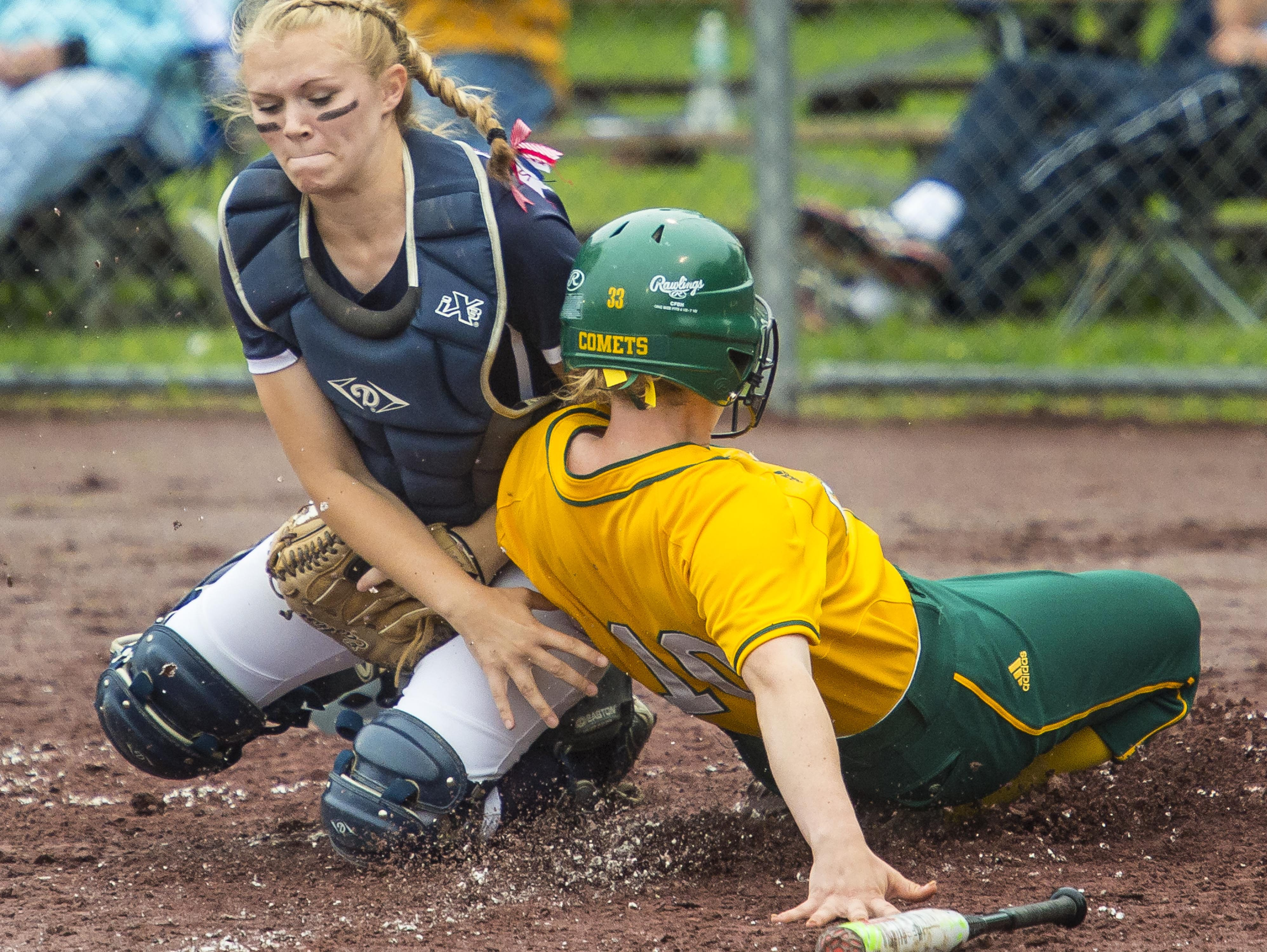 Mt. Anthony's Julie Elwell, left, tags out BFA's Chrissy Lawton at home during the Division I state high school softball championship in Poultney on Monday, June 15, 2015.
