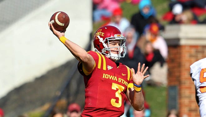 Oct 26, 2013; Ames, IA, USA; Iowa State Cyclones quarterback Grant Rohach (3) throws during the third quarter against the Oklahoma State Cowboys at Jack Trice Stadium. Oklahoma State defeated Iowa State 58-27. Mandatory Credit: Brace Hemmelgarn-USA TODAY Sports