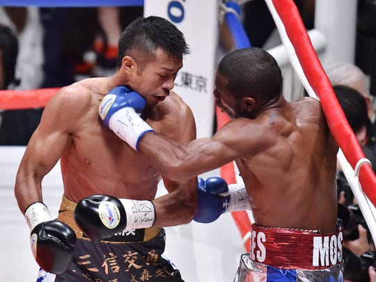 TOKYO, JAPAN - APRIL 27:  Jazreel Corrales of Panama (R) punches Takashi Uchiyama of Japan (L) during the WBA Super Featherweight title bout between Takashi Uchiyama and Jezreel Corrales at Ota City General Gymnasium on April 27, 2016 in Tokyo, Japan.  (Photo by Atsushi Tomura/Getty Images) ORG XMIT: 634189967 ORIG FILE ID: 524862176