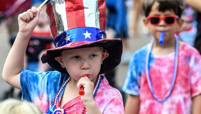 Will Lafferty blows a whistle while walking in First Baptist Church's Weekday Education's annual Fourth of July parade, in Oxford, Miss., on  July 3, 2018.