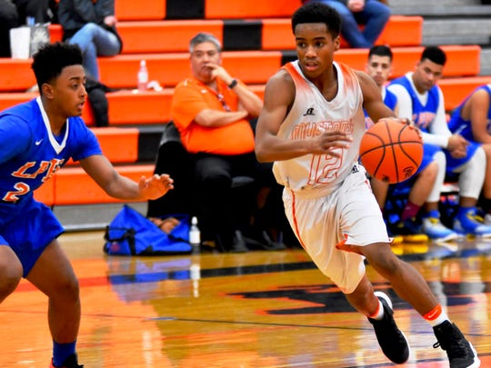 Northville's Robert Johnson III (right) makes his move