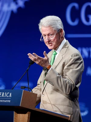 Former President Bill Clinton speaks during the closing session on the final day of the annual gathering of the Clinton Global Initiative America. The Clinton Global Initiative will honor the Coalition of Immokalee Workers on Sept. 21