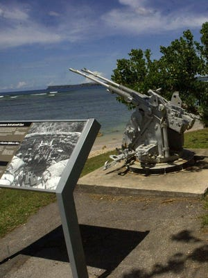 Signs explain the Japanese guns at War in the Pacific National Historical Park, Ga'an Point, in Agat in 2003. Help keep Guam beautiful by joining a community cleanup at 9 a.m. Aug. 13 atGa'an Point — a former World War II invasion beach.