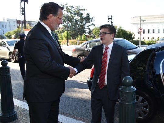 "Sen. Gary Peters greets Thomas Stephenson, ""Senator"