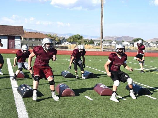 The Dayton High School football team does agility training during practice.