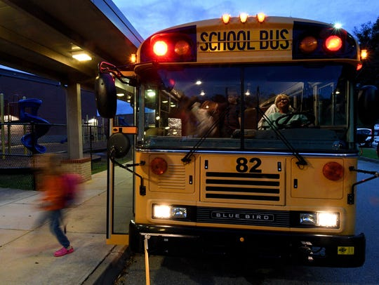 Knox County school buses unloading students at Cedar