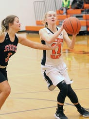 Gibsonburg's Emily Roberts looks for a shot against