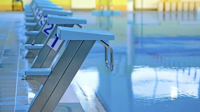 Swimming pool with starting blocks