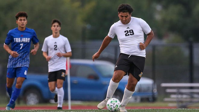 Newton's Eduardo Lopez-Garcia dribbles down the field in the first half against Andover on Thursday, Sept. 17 at Trojan Stadium. The Railers dropped the match 3-1