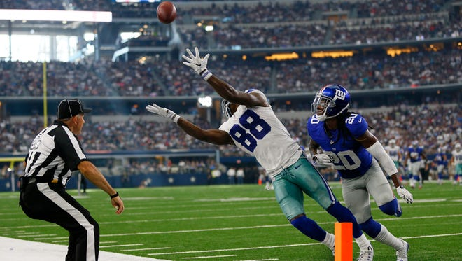 Dallas Cowboys wide receiver Dez Bryant (88) misses a possible touchdown catch as New York Giants cornerback Janoris Jenkins (20) defends at AT&T Stadium.