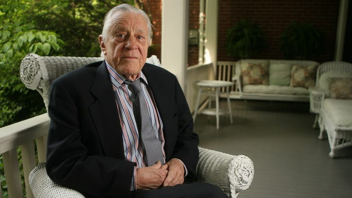 Ben Bradlee of Washington Post sits on the porch of