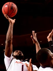KT Harrell scored 18 of his 20 points int eh second half to lead Auburn to a 83-73 win over Milwaukee.