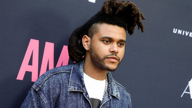 """The Weeknd's """"Can't Feel My Face"""" is the No. 1 iTunes track as of July 16."""