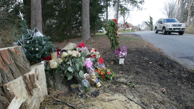 A memorial of flowers, pictures, holiday decorations and candles to Lauren D'Amato are placed at the scene along Hanover Street in Yorktown Heights in December 2010. The 20-year-old Yorktown teen died of injuries suffered in a fiery crash earlier that week.