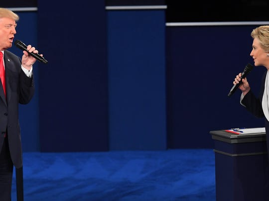 Oct 9, 2016; St. Louis, MO, USA;  Democratic presidential candidate Hillary Clinton and Republican presidential candidate Donald Trump during the second presidential debate at Washington University in St Louis. Mandatory Credit: Jack Gruber-USA TODAY NETWORK