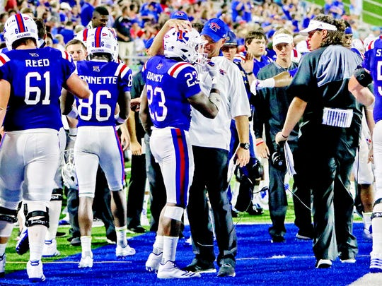 Louisiana Tech head football coach Skip Holtz congratulates redshirt sophomore running back Jaqwis Dancy after scoring his first career touchdown Saturday during the team's 52-24 victory over Northwestern State at Joe Aillet Stadium.
