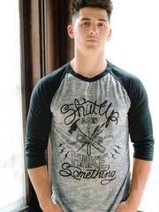 T-shirt by Acanthus Apparel.