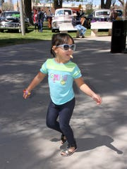 "There was one Mercedes on exhibit that did not run on four wheels during the 20th Anniversary Smok'n Oldies Class Car Show held Saturday at Luna County Courthouse Park. Mercedes Longoria, 4, twirled like a top to ""Oldies, but Goodies"" music spun by DJ Randy Lynch at the park's gazebo. While car enthusiasts took in over 91 entries – mostly from Detroit's hey-day – Mercedes showed off her dance skills while shelling peanuts with her grandfather Rayco Martinez. She is a dancer for the Luna Stars in Deming."