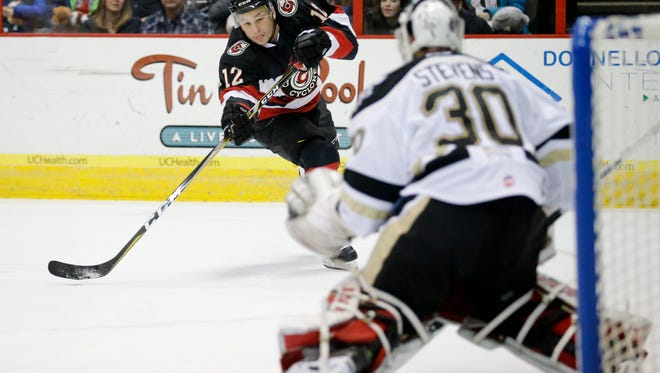 Cyclones forward Jesse Schultz (12) shoots on goal in the first period of the EHL hockey game between the Cincinnati Cyclones and the Wheeling Nailers at US Bank Arena in downtown Cincinnati on Saturday, Jan. 6, 2018.