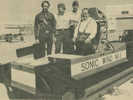 Dr. John Paul Stapp rides the Sonic Wind No. 1 at a more sedate speed in the Space Hall dedication parade in 1976. The famous sled was on its way to a new home in the museum's John P. Stapp Air & Space Park. On August 9 of this year, the sled will take yet another ride. This time, to Washington, D.C. where it will be refurbished by the Smithsonian and then featured in a new National Air and Space Museum exhibit.